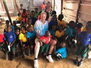 Rob VanHoose and some of his new friends in Uganda.