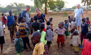 Amy and Chris Compston with the children in Uganda.